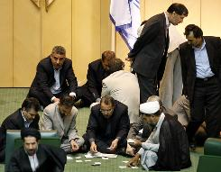 Iranian lawmakers count votes for the cabinet list proposed by Iranian President Mahmoud Ahmadinejad.