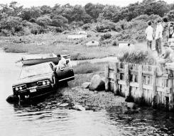 Sen. Edward Kennedy's car is pulled from the water in Edgartown, Mass., after an accident that killed his passenger, Mary Jo Kopechne.