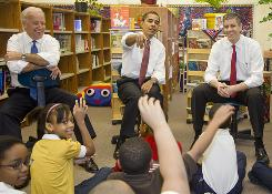 President-elect Barack Obama, flanked by Vice President-elect Joe Biden, left, and future Secretary of Education Arne Duncan, speaks to elementary school children on Dec. 16 in Chicago.