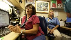 """Registered nurse Judith Miller works three 12- to 16-hour shifts each week in the emergency room. """"The first couple of times we did twleves we thought, 'Oh, that's horrible.' Now, an eight hour shift seems like a prince's shift,"""" Miller said around 3 a.m. on Aug. 25."""