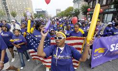 Shirley Harris, center, leads Service Employees International Union families down a Detroit street.