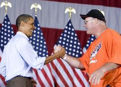 President Obama shakes hands with union member Charlie Dilbert at an AFL-CIO Labor Day picnic in Cincinnati.