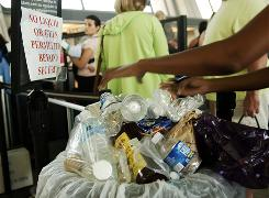 A trash container overflows with bottles and other liquid items near the security checkpoint at Dulles Airport ouside Washington, D.C., on Aug. 10, 2006, the day the ban went into effect.