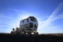 NASA scientists last October began trials of the Small Pressurized Rover at Black Point Lava Flow, north of Flagstaff, Ariz., on terrain that has the rockiness of the moon's surface. The vehicle is designed to allow astronauts the travel relatively long distances from a lunar base station without bulky spacesuits.