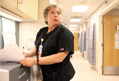 Deborah Franklin, 61, reviews charts for incoming patients and provides them with medication once a doctor's order has been received.