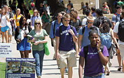 Students walk the campus of Texas Christian University in Fort Worth, on Aug. 25. Multiple confirmed cases of swine flu have been reported at the private university.