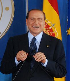 Italian Premier Silvio Berlusconi, shown smiling during a press conference Thursday, said he would not resign in the wake of a sex scandal.