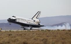 The Space Shuttle Discovery lands at Edwards Air Force Base in California on Friday. Discovery returned to earth from mission STS-128 which delivered supplies and equipment to the International Space Station.