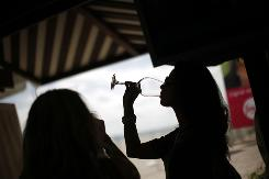 Women drink wine during the Wine and Food Festival in Miami Beach in February.