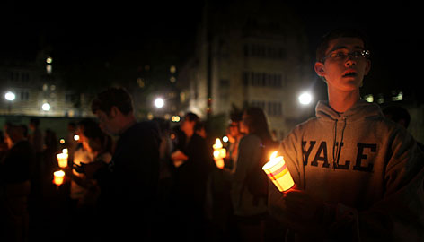 Yale students attend a candlelight vigil Monday for fellow student Annie Le, 24, whose body was found behind a wall Sunday night in a laboratory building near the Yale Medical School in New Haven, Conn.