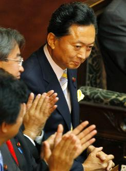 Japan's parliament named Yukio Hatoyama, center, acknowledges as the country's prime minister at the lower house of parliament on Wednesday in Tokyo, Japan.
