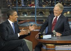 "Obama, left, talks with host David Letterman on the set of ""The Late Show With David Letterman,"" on Sept. 10, 2008. It was Obama's fifth visit to the show. Obama will sit down with Letterman again on Monday."