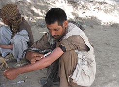Khord Agha, 28, gets ready to shoot a dose of heroin. United Nations and Afghan officials say heroin use among Afghans is surging.