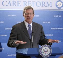 U.S. Sen. Max Baucus, D-Mont., chairman of the Senate Finance Committee, discusses the healthcare reform bill during a Wednesday news conference on Capitol Hill.