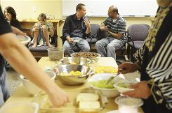 Ben Ries, pastor of the Sterling Drive Church of Christ, talks with Monem Salam as a group of local Muslims meet at a community room at the Bellingham RE Store to break their daily Ramadan fast and pray together, in Bellingham, Wash. Ries has decided to participate in day-long fasts during Ramadan.