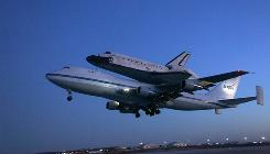 The space shuttle Discovery, mounted atop a modified Boeing 747 shuttle carrier, lifts off from Edwards Air Force Base, Calif., on Sept. 20. The space shuttle Discovery is on a cross-country flight to Florida after landing from space earlier this month in Southern California.