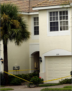 Police tape secures the scene outside a residence on Sunday in Naples, Fla. A woman and her five children were found dead Saturday in their apartment.