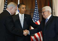 President Obama watches Tuesday in New York City as Benjamin Netanyahu, left, and Mahmoud Abbas shake hands.