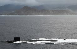 The Virginia-class attack submarine USS Hawaii passes Diamond Head crater as it sails into its new homeport of Pearl Harbor, Hawaii on July 23. Submariners live in exceptionally close quarters, even taking turns sleeping in the same bunks on attack submarines.
