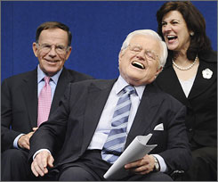 Wife Victoria, right, and friend Paul Kirk Jr., left, share a laugh with Sen. Edward Kennedy at the annual Profile in Courage Award ceremonies May 12, 2008, in Boston.