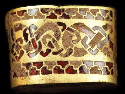 A hilt fitting, part of a huge hoard of Anglo-Saxon treasure unearthed by an amateur searcher with a metal detector in England.