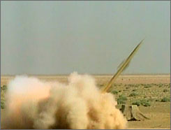 A screen grab from Iran's official English-language TV station shows a test-launch of a short-range missile in Qom, south of Tehran on Sunday.