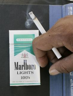 Some public health experts are questioning why menthol cigarettes weren't banned along with flavored cigarettes. Teens and African-American smokers tend to prefer menthol, studies say.
