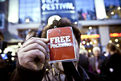 "A man holds a ""Free Polanski"" sticker at the Zurich Film Festival on Sunday. Director Roman Polanski was arrested by Swiss police as he flew in for the festival and faces possible extradition to the United States for having sex with a 13-year-old girl in 1977, authorities said Sunday."