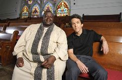Rev. Henry Covington and Mitch Albom sit in the balcony of Pilgrim Church in Detroit. Albom has a new book, Have a Little Faith, that looks at love, faith, and duty through his relationships with his childhood rabbi, a beloved person who is dying and wants Albom to do his eulogy, and this Detroit pastor.