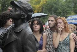 People react during the ceremony at the new monument for victims of the Babi Yar massacre in Kiev, Ukraine. More than 33,700 Jews were rounded up and shot at Babi Yar over 48 hours beginning on Sept. 29, 1941. In the ensuing months, the ravine was filled with an estimated 100,000 bodies, among them those of non-Jewish Kiev residents and Red Army prisoners of the Nazis.