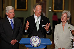 Sen. Tom Carper, D-Del, center, speaks on Capitol Hill on July 23 after meeting with Sen. Christopher Dodd, D-Conn., left, and and Secretary of Health and Human Services Kathleen Sebelius. Carper scheduled a hearing for Wednesday discussing new Government Accountability Office findings on Medicaid fraud.