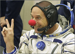 Canadian billionaire entertainer Guy Laliberte, a crewmember of the 21st mission to the International Space Station, ISS, gestures while wearing a clown nose prior to the launch of the Soyuz-FG rocket at the Russian leased Baikonur Cosmodrome, in Kazakhstan on Wednesday.