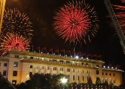 Fireworks explode over the Great Hall of the People to mark the 60th anniversary of the founding of the People's Republic of China in Beijing.