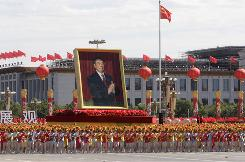 Chinese President Hu Jintao's portrait moves past the Tiananmen Square during a parade celebrating China's 60th anniversary in Beijing, China on Thursday, To mark 60 years of communist rule China put together its biggest-ever military parade: hundreds of thousands of marchers, batteries of soldiers and weaponry from drone missiles to amphibious assault vehicles.