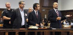 Attorney Gerald Shargel, right, speaks Friday on behalf of his client, Robert J. Halderman, foreground left, at Manhattan Supreme Court. Attorney Evan L. Lipton, listens in the center.