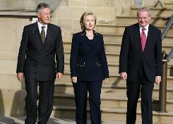 Secretary of State Hillary Clinton, center, leaves Stormont Castle in Belfast, on Monday with Northern Ireland's First Minister Peter Robinson, left, and Deputy First Minister Martin McGuinness. Clinton was in Belfast to offer renewed U.S. support for Northern Ireland's peace process.