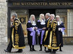 Judges look on as Lord Phillips (2nd left), Lord Hope (left), Lord Rodger (2nd right) and Lord Walker (3rd right) arrive for a service at Westminster Abbey in central London to mark the start of the new legal year in England and Wales on Thursday.