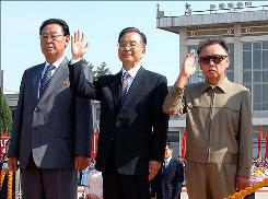 Chinese Prime Minister Wen Jiabao, center, and North Korean leader Kim Jong Il, right, gesture while accompanied by North Korean Prime Minister Kim Yong Il upon Wen's arrival at Pyongyang Airport on Sunday.