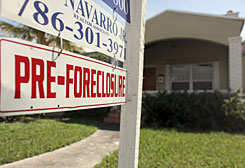 "A pre-foreclosure sign is displayed outside a home on Thursday in Miami. A new study by the Brennan Center for Justice found that many people now face complicated foreclosure proceedings with ""no opportunity to obtain help from a lawyer."" The deluge is hitting cities across the country, including Cleveland, Las Vegas, Washington, Phoenix and Miami."