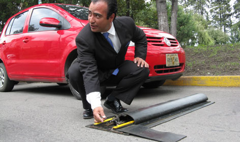 Carlos Cano, president of Mexico's Decano Industries, shows the speed bump prototype.