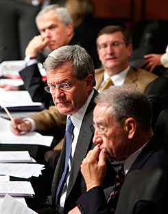 Max Baucus, D-Mont., second from bottom, chairs the Senate Finance panel at a hearing last month.
