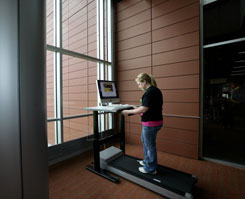 Senior Emily Smak, 20, tries out the treadmill workstation in one of the study lounges in the new Education and Human Services Building at Central Michigan University. There is a new iMac computer attached to it so students can get a little exercise while doing homework or other things on the computer.