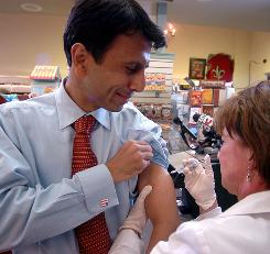 "Louisiana Gov. Bobby Jindal gets a flu shot. He says fellow Republicans should offer more ""pro-active solutions"" to addressing the nation's health care impasse."