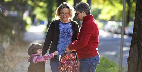 Leah McElrath, center, and Cathy Renna walk their 4-year-old daughter, Rosemary McElrath Renna, to school Thursday in Washington.