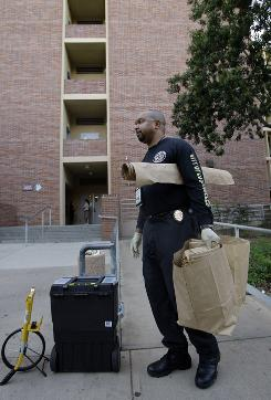 Los Angeles Police Department Scientific Investigation Division criminalist Nand Hart-Nibbrig arrives on the UCLA campus outside Young Hall in Los Angeles on Thursday.