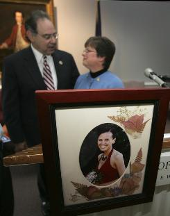 AnnMarie Morse stands behind a photograph of her daughter with U.S. Rep. Paul Hodes, D-N.H., following a news conference in Concord, N.H., on Friday about Michelle's Law, which is named after Morse's daughter Michelle Morse.