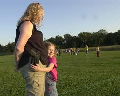 Isabella Hain, 5, gives her mother, Meleanie Hain, a hug in a Sept. 23, 2008, file photo at Optimist Park in Lebanon, Pa.