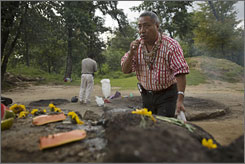 Guatemalan Mayan Indian elder Apolinario Chile Pixtun gestures as he pays his respects at an altar within the Iximche ceremonial site in Tecpan, Guatemala.
