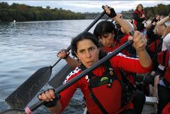 "Sharon Ezersky, 49, practices for a dragon boat race in Philadelphia. She had a double mastectomy after being diagnosed with DCIS: ""I didn't want to worry."""