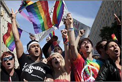 Gay-rights activists yell during a rally in Washington on Sunday.